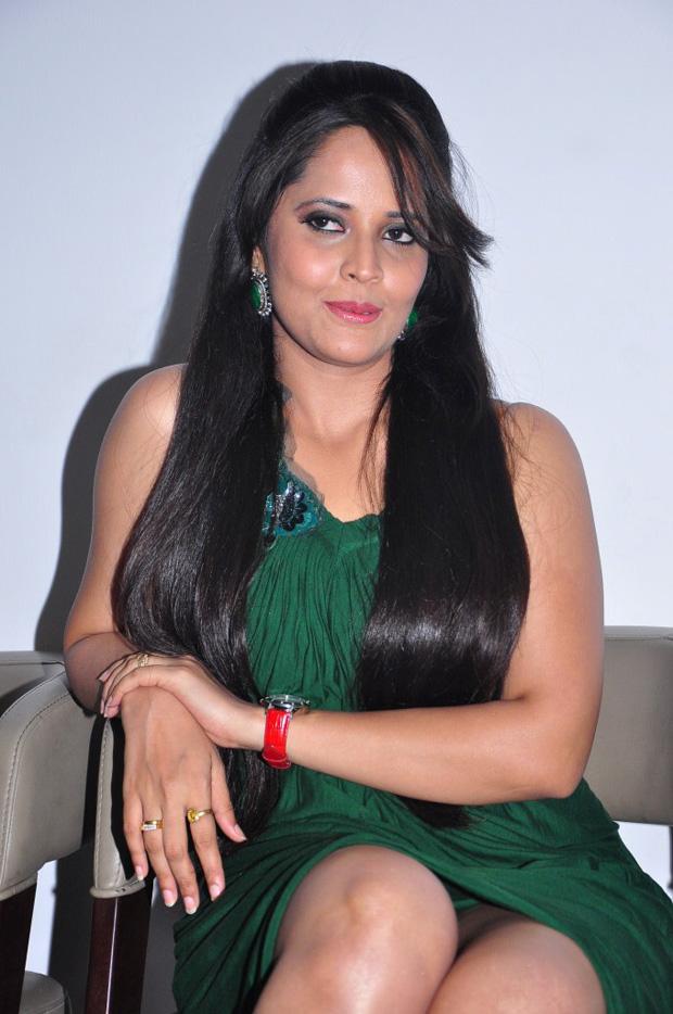 Telugu Tv Anchor Anasuya Hot Thigh Show In Green Dress At Movie Audio Launch