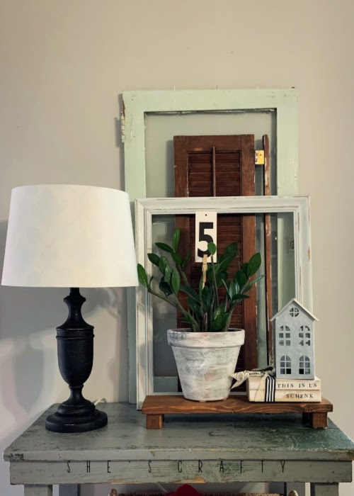 How to make a DIY decorative book stack |  add a distressed book stack to a vintage home decor vignette