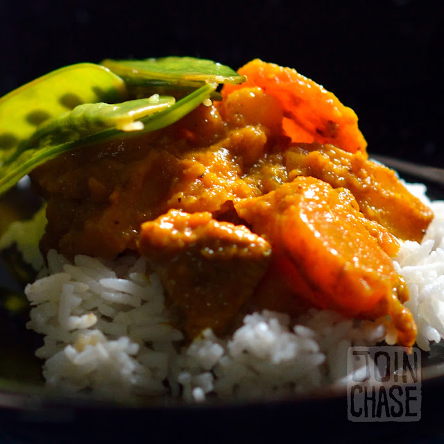 Potato and pumpkin chicken curry served with fresh snow peas.