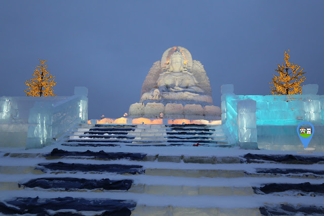 Guanyin (the Goddess of Mercy and Compassion) Ice and Snow Sculpture at Harbin Ice Sculpture Exhibition in Heilongjiang, China