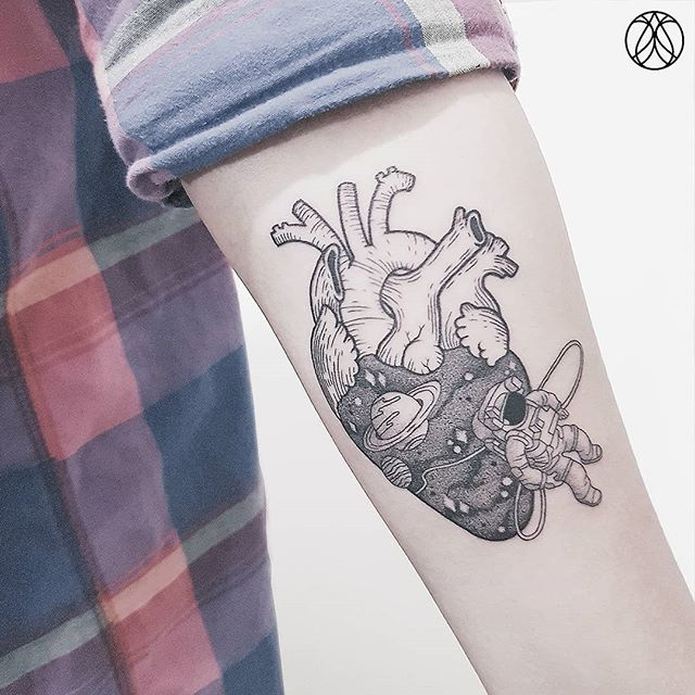 astronaut and heart tattoo