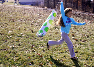The day was mild and there was a nice breeze, so Tessa had a wonderful time flying her windsock like a kite. It work well when we hung it on a post to tell wind direction too!