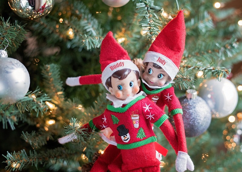 elf on the shelf on a christmas tree