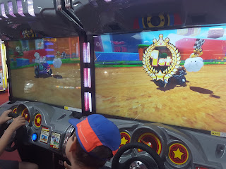 Dan Jon winning on Mario Kart at the Amusements.