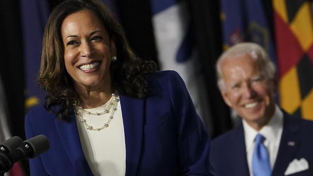 Kamala Harris and Joe Biden, smiling