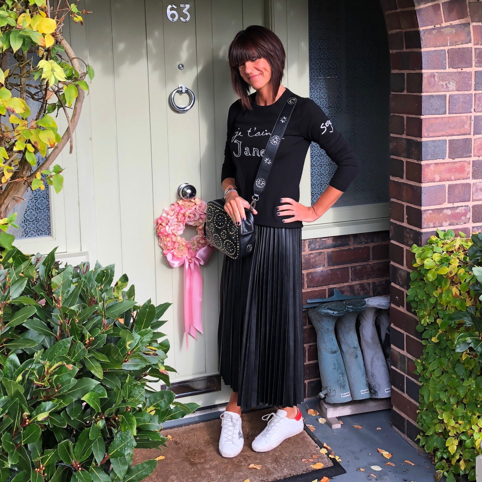 my midlife fashion, marks and spencer pleated midi skirt, village england pemberton studded across body bag, golden goose superstar low top leather trainers, bella freud je taime jane jumper