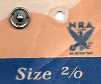 Close-up shows logo on package of snaps.