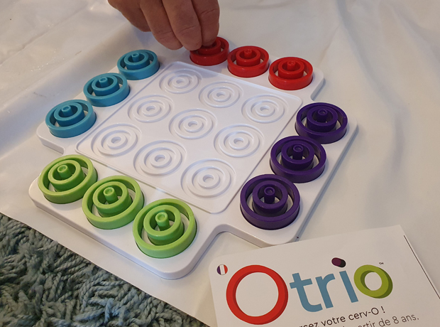 Otrio is a challenging updated crazy version of tic-tac-toe