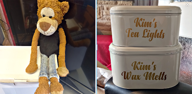 A monkey soft toy and two tins for wax melts.