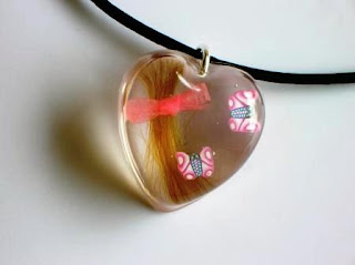 Hair and butterfly heart shaped pendant