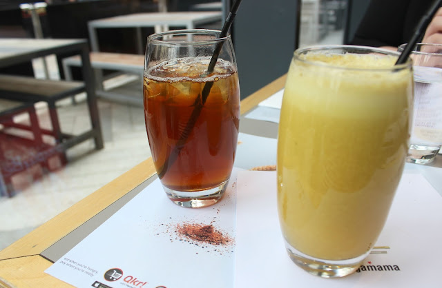 A picture of Wagamama Peach Tea and Tropical Juice