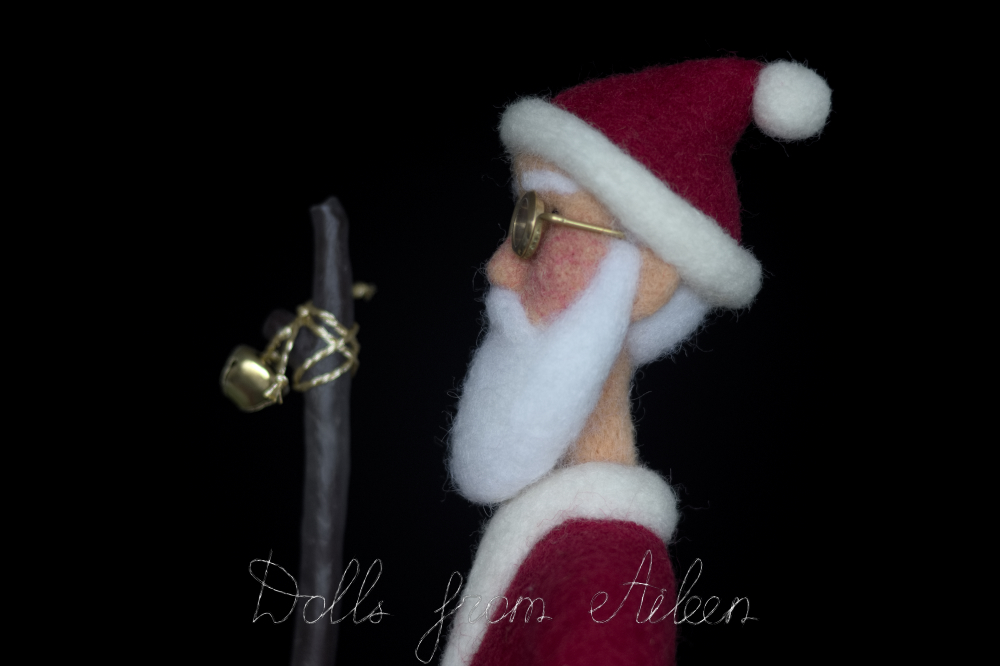 Profile view of OOAK needle felted Santa Claus doll