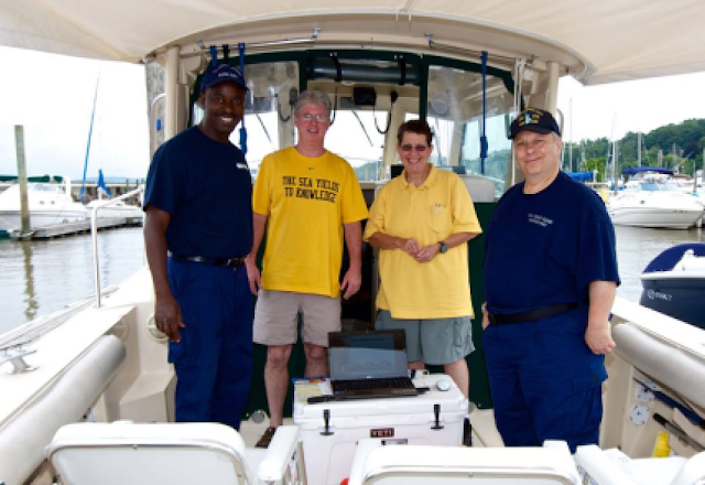 Lynn Glassman and Robert Daraio teaching a boating safety class