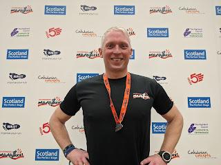 Neil Mapes, portrait finish photo after Inverness Half Marathon 2020
