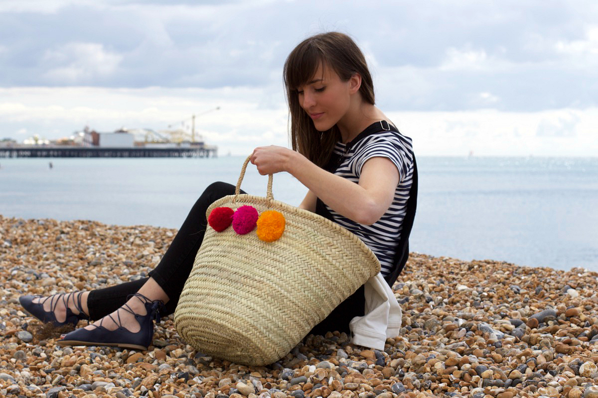 felicity in new look with her moroccan pom pom woven basket bag from postcards home