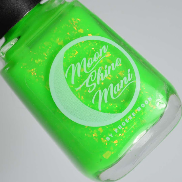 bright green nail polish with flakes in a bottle
