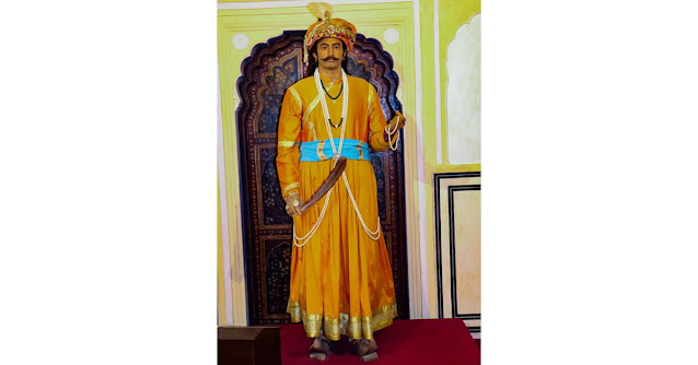 Maharaja's standing mannequin at Hawa Mahal Jaipur with the pen still in his hand showcases his intense love and faith for Lord Krishna