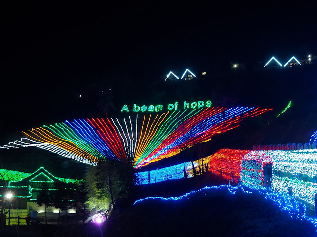 """A Beam of Hope"" and light tunnel display at the Light Festival at Boseong Green Tea Plantation, South Korea"
