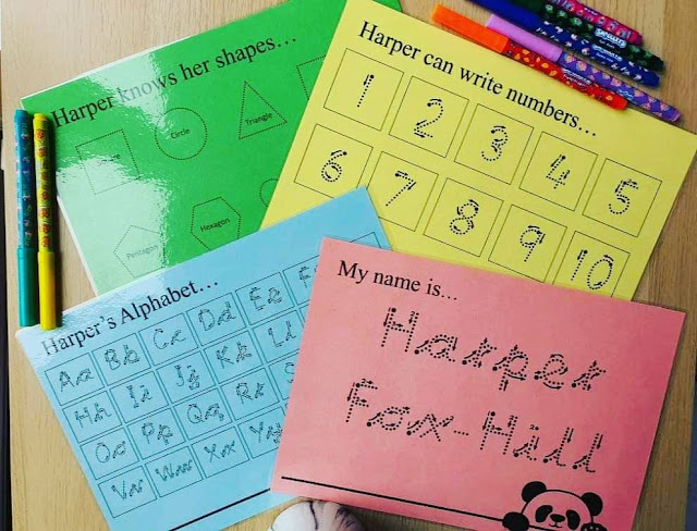 4 coloured laminated cards with the alphabet, the child's name, numbers and shapes copyright Panda Personal Designs