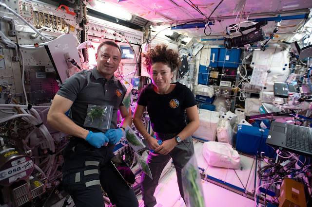 Drew Morgan alongside Jessica Meir aboard the ISS