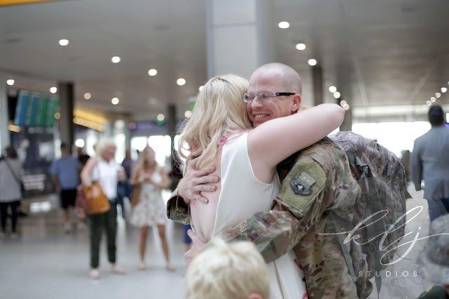 family portraits at the Sacramento airport for airforce home coming.