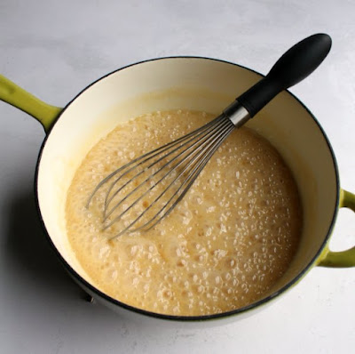 saucepan of boiling milk and sugar mixture for fudge