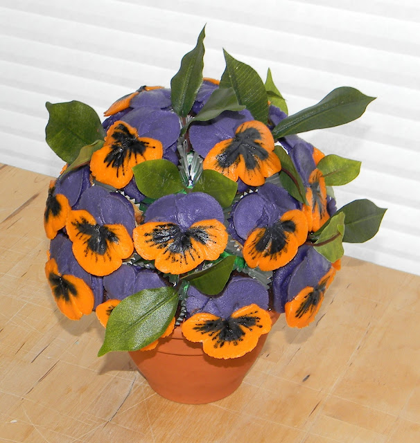 blossom cakes  purple and orange pansy bouquet