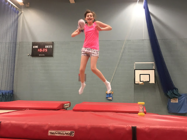 Sasha bouncing on a trampoline
