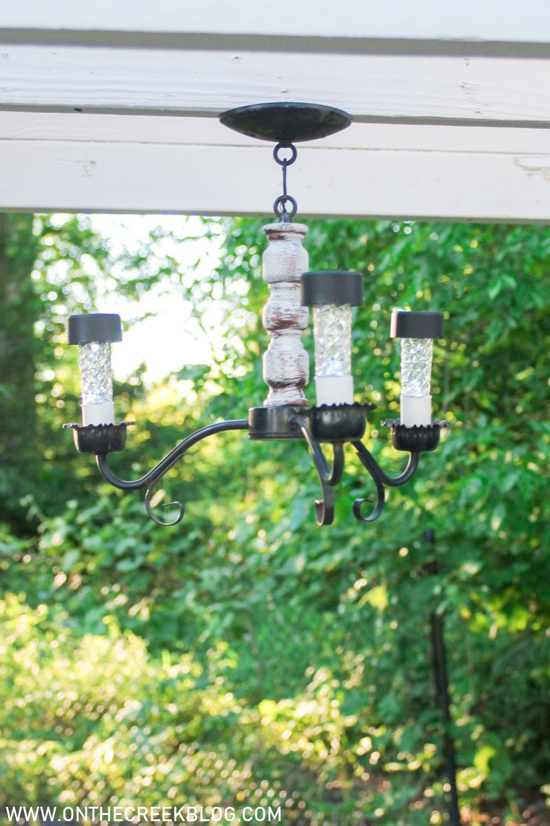 Creating a chippy & distressed solar powered chandelier | On The Creek Blog