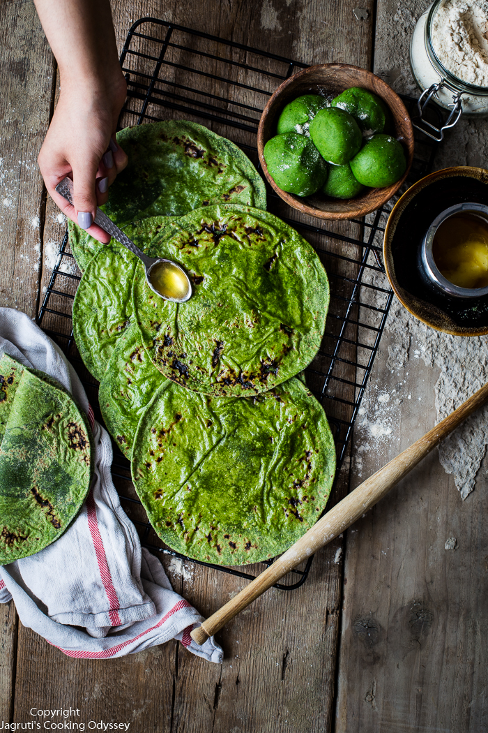 These Indian style green spinach flatbreads are laid on a cooling wire rack.