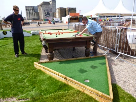 The 7th hole of the Golf Apocalypse course in London used a snooker table