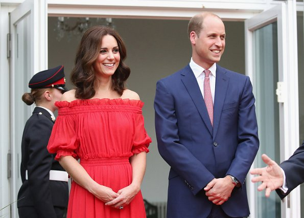 Kate Middleton's dress is by Alexander McQueen Off-the-shoulder shirred cotton and silk-blend. Simone Rocha Crystal earrings, Prada Pumps, Club Monaco Channon Heeled Sandal