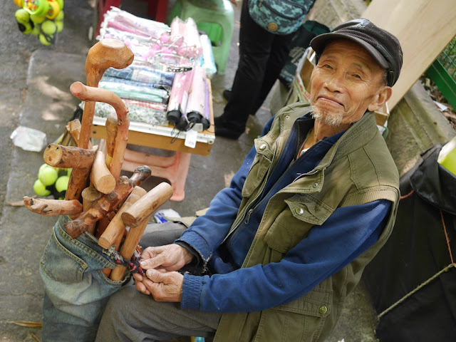 man selling wood canes in Guiyang