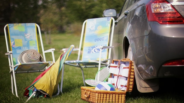 Camp chairs, umbrellas, and sports equipment