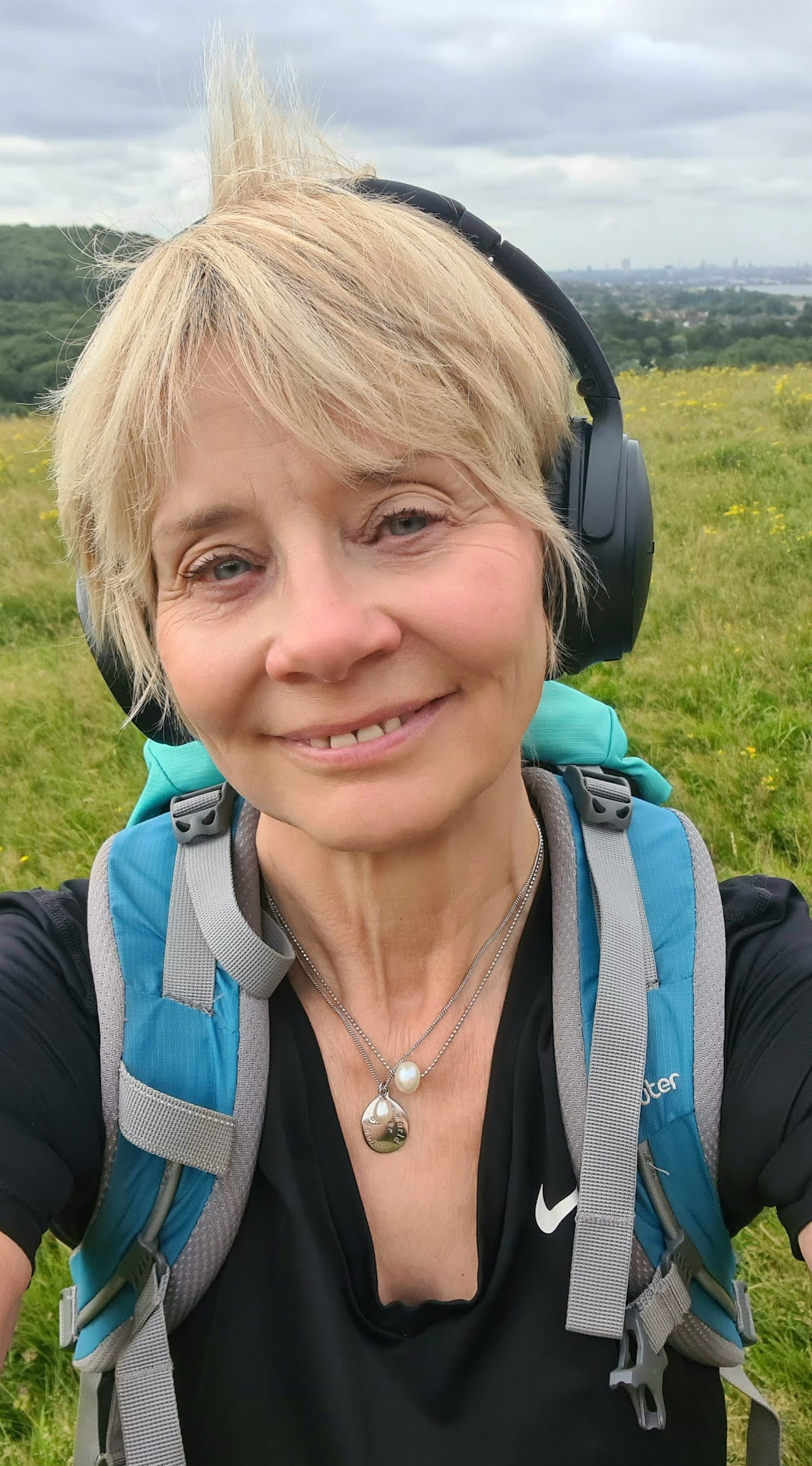 Wearing headphones on a country walk, Is This Mutton's Gail Hanlon with her monthly digest of podcast, TV and book recommendations