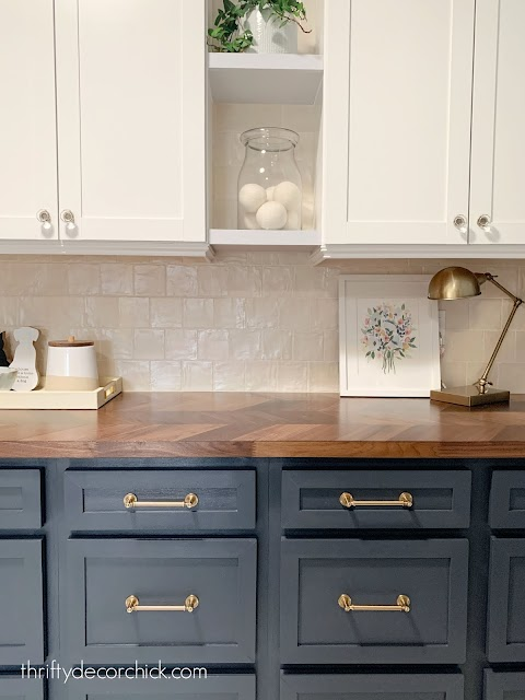 Laundry room counter with cream tile blue cabinets