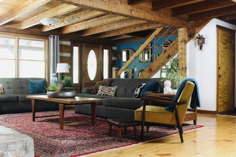 log home living room decorating ideas narrow dining combo hood creek cabin bold eclectic the og lodge global midcentury red persian rug