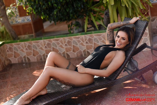 Gemma Massey smiling sexy in black bodysuit