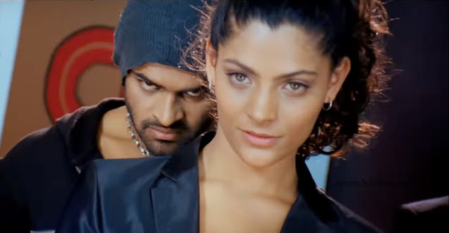 Rey (2015) is an Indian Telugu action dance film produced and directed by Y.V.S. Chowdary in 2015. The film is starred by Sai Dharam Tej, Saiyami Kher and Shraddha Das in the lead roles and Tanikella Bharani, Ali, Venu Madhav, Arpit Ranka, Raghu Babu, Jaya Prakash Reddy, Naresh and others in the supporting characters.  The film is about 'Two pop singers from Mexico and Jamaica compete to be the 'Best in the world'.'   Sai Dharam Tej and Saiyami Kher in Rey (2015) Movie   Jenna a famous pop singer wins twice 'the best in the world' title in epicenter music completion, USA. So, she wants to achieve a hat trick by winning the title in this year. Dange a Mexican don always assists her to be close to her. On the other hand the Rock the lead character in the movie is of a very flirting character and always flirts to any girls. Actually not like that, culture of this country is like that. Amrita comes to Jamaica from India to materialize her brother's dream winning the best of the world. She joins at a Jamaican music college where Rock is also a student. In the first time he flirts her don't want to know girl's emotion. His mind is changed latter. The college principal keeps Amrita in 'F' group where Rock and his useless friends are also in her group and she is the leader of the group. When Rock understands Amrita's emotion and her brother's dream, he falls in love with her and wants to materialize her dream in any situation. 'Rey' is their group's name. Jenna tries to interrupt their group so that they cannot win the title. At last Amrita can know that Amrita has murdered her brother Sandy to win title former with the assistance of Dange.   Sai Dharam Tej and Saiyami Kher in Rey (2015) Movie   Jenna tries to kill Rock but fails. Rock kills Dange running car over him. At last 'Rey' group wins the title 'Best of the world.' The video of Jenna, attempting to murder to Rock becomes viral on You Tube and she becomes loose. Amrita admits about her love affair to Rock.  The film