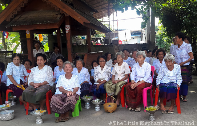 Old ladies at village temple in Nan - Thailand