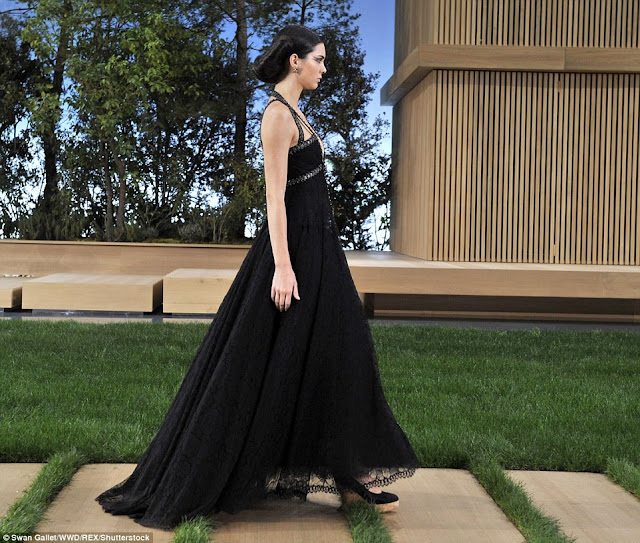 Kendall Jenner flaunts plunging neckline at Chanel's doll house themed Couture show