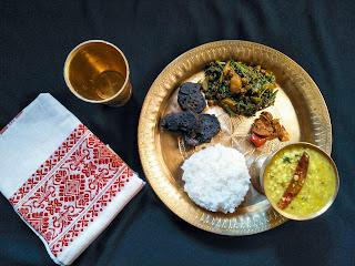 A simple Assamese lunch : matidail (split black gram) , dhekia xaak bhaji (fiddlehead ferns),  bhedailotar bor (skunk vine fritters) and ou tenga achar (elephant apple pickle).