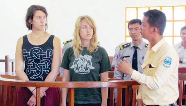 Two foreign women appear at Siem Reap Provincial Court after they were caught posing nude at a temple in February 2015. Photo supplied