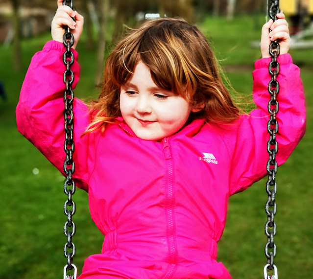 Girl swinging on a swing by Katrina Over 30s UK blogger talking about parenting, autism, mental health, books and coeliac disease for What The Redhead Said Living Arrows UK Parenting Blog Link Up Inspired by Khalil Gibran Quote