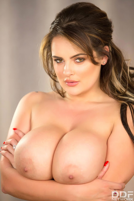Katie Thornton big naked boobs between arms