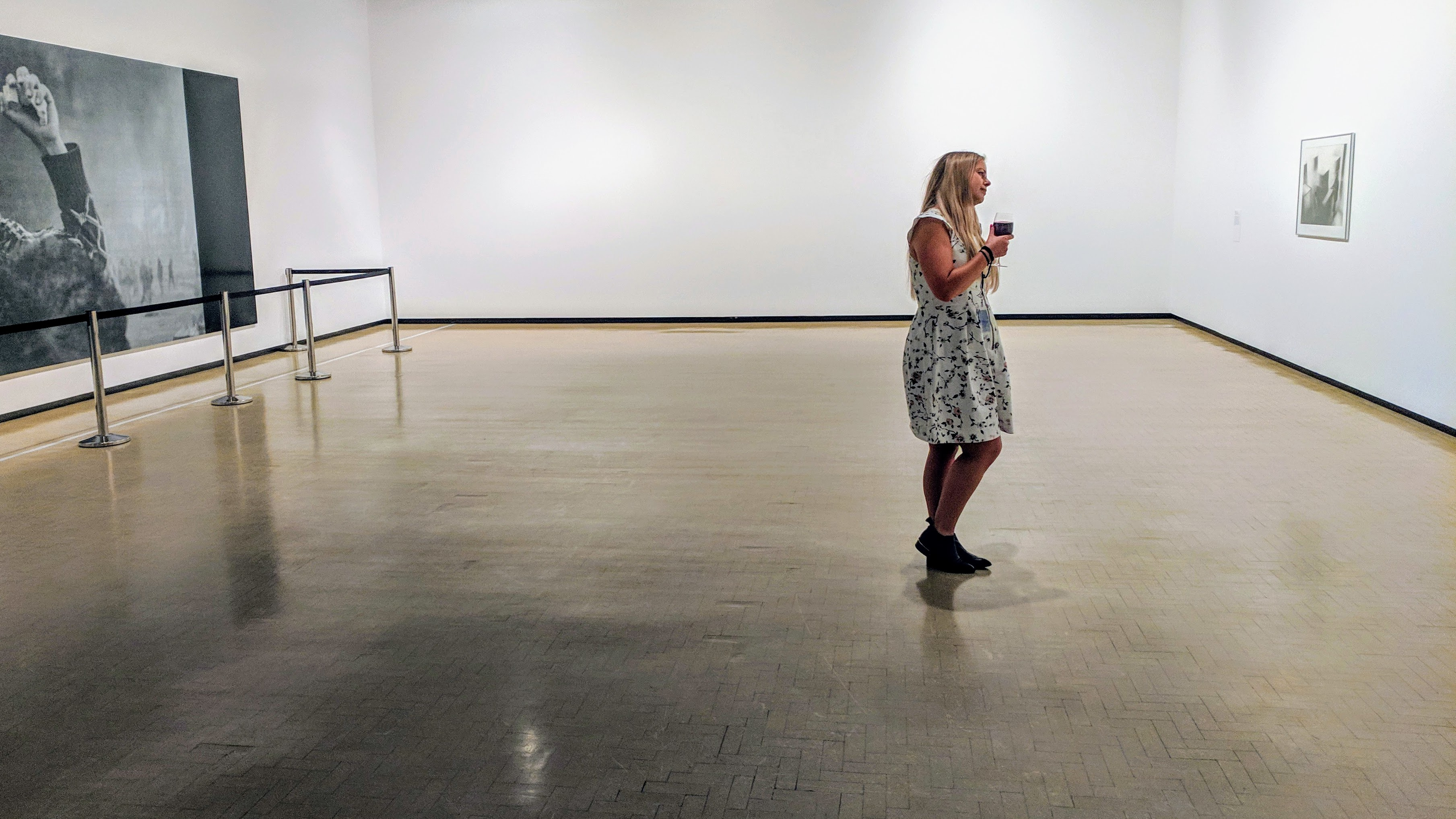 Woman admires art in a gallery