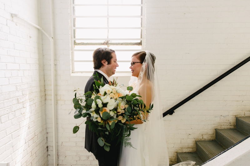 first look at ambient plus studio wedding with bride and groom
