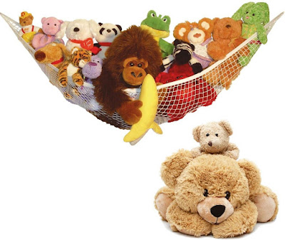A hammock hanging filled with soft toys