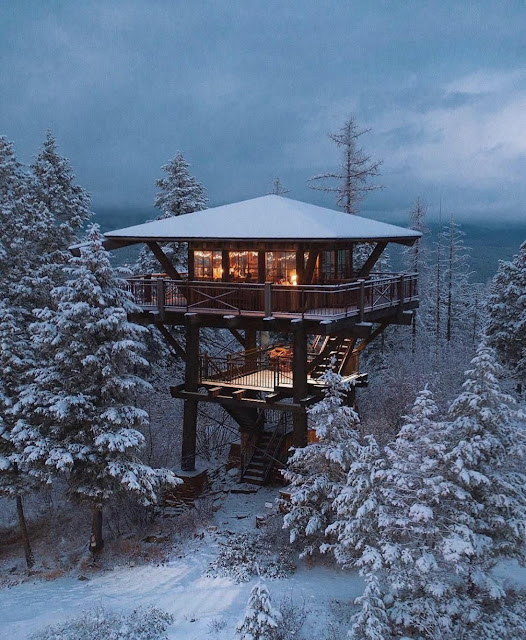 Raised cabin in with snowy surroundings