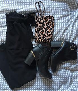 https://www.boohoo.com/slinky-leopard-print-square-neck-high-rise-bodysuit/DZZ19815.html